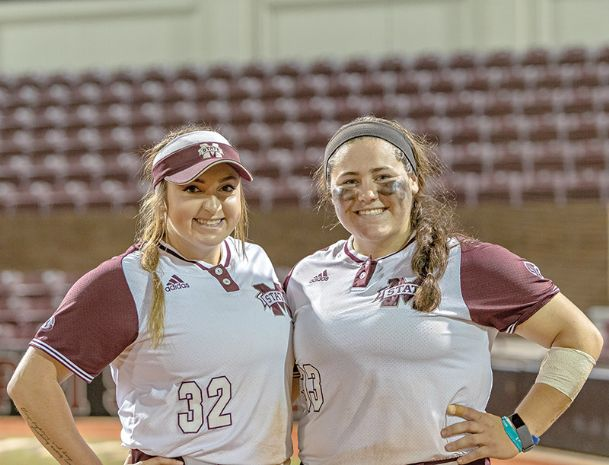 Sisters Montana Davidson, left, and Mia grew up in a military family and became Mississippi State Bulldogs on the same day in 2013.
