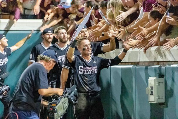 Jake Mangum celebrates with the fans after Sunday's super regional victory over Stanford at Dudy Noble Field. Mangum, nicknamed