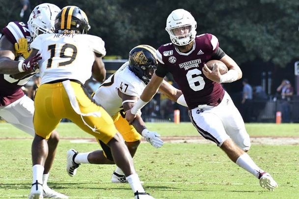 Mississippi State quarterback Garrett Shrader runs the ball as he is defended by Southern Miss linebacker Terry Whittington during the third quarter Saturday at Davis Wade Stadium.