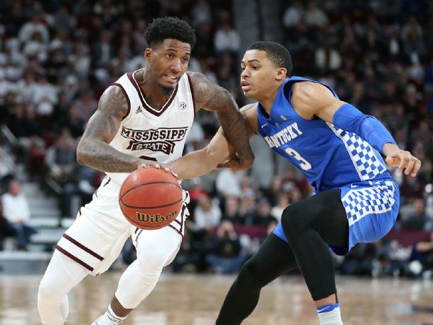 Mississippi State guard Nick Weatherspoon (0) drives around Kentucky guard Keldon Johnson (3) during Saturday's game at Humphrey Coliseum.