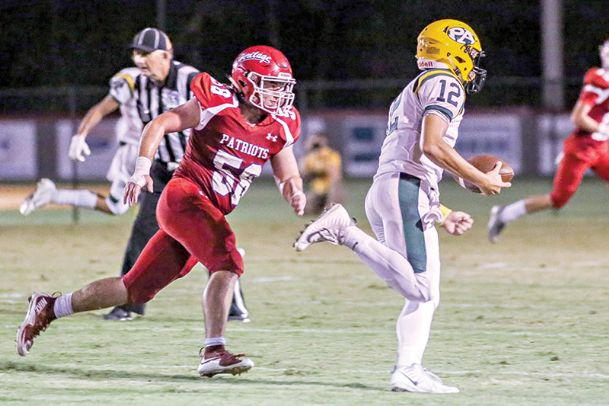 Heritage Academy's Parker Ray chases down an opposing quarterback in a game last season.