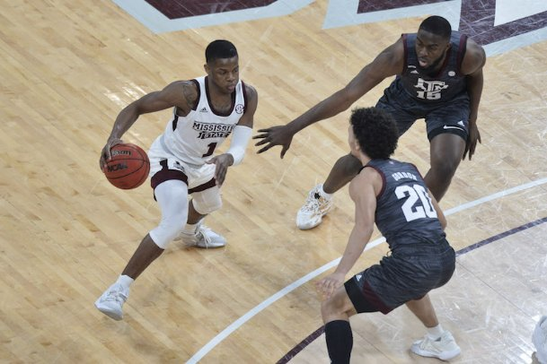 Mississippi State guard Iverson Molinar (1) handles the ball while defended by Texas A&M forward Jonathan Aku (15) and guard Andre Gordon (20) during the first half of Wednesday's game at Humphrey Coliseum.