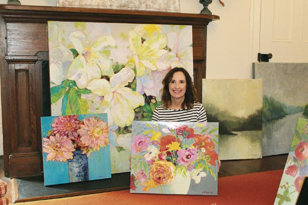 Virginia Branch is pictured Tuesday with several of her acrylic paintings to be featured in the exhibit Modern Florals and Mystical Landscapes at the Columbus Arts Council's Rosenzweig Arts Center in October. The public is invited to an opening reception Thursday from 5:30-7 p.m.