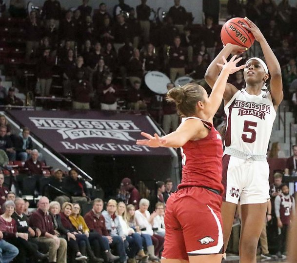 Mississippi State's Rickea Jackson (5) shoots a three-point shot over Arkansas' Chelsea Dungee (33) during the first half of their NCAA college basketball game Thursday in Starkville.