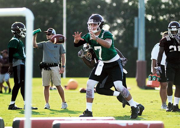 Mississippi State quarterback Nick Fitzgerald takes a snap in a practice earlier this month. Fitzgerald remains in competition for the starting quarterback job with Damian Williams, Nick Tiano, and newcomer Wyatt Roberts.