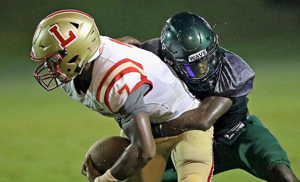 West Point safety Tyler Rupert (4) tackles Lafayette quarterback Randy Anderson (7) during a game earlier this season.