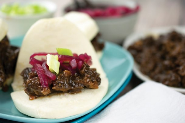 Chinese style bao buns with pickled red onions bring a Far East flavor to your table.