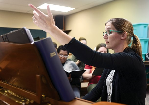 New Columbus Choral Society Artistic Director and Conductor Jayne Doolittle of Caledonia leads the group in rehearsal at First Baptist Church on Oct. 22 for the upcoming