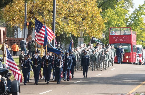 Citizens march in downtown Columbus for the annual Veterans Day parade in 2018 in this Dispatch file photo. Both Columbus and Starkville will host parades again on Saturday in honor of veterans and their families throughout the Golden Triangle community.