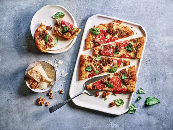 This pizza uses walnuts as an alternative to sausage.