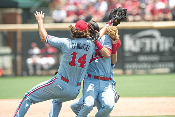 Mississippi Rebels first baseman Cole Zabowski (14) collides with shortstop Grae Kessinger (center) and second baseman Jacob Adams (back) while going for a pop up fly ball during the game against the Arkansas Razorbacks at Baum-Walker Stadium