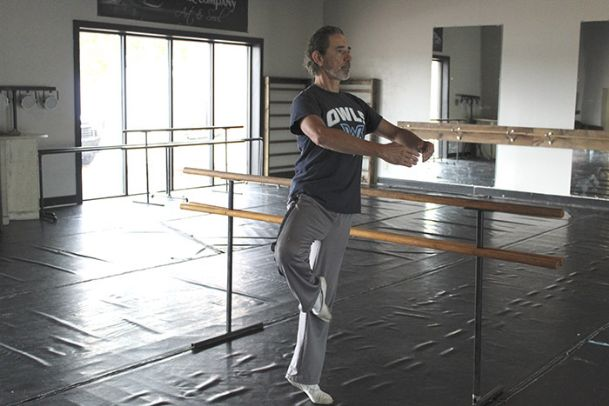 Dolan Shoemaker stretches in a studio at Wherehouse Dance Company in Columbus, where he serves as ballet master. He started dancing at age 19, and went on to dance professionally with Jackson-based Ballet Mississippi. At 57, he teaches intermediate and advanced classes at Wherehouse.