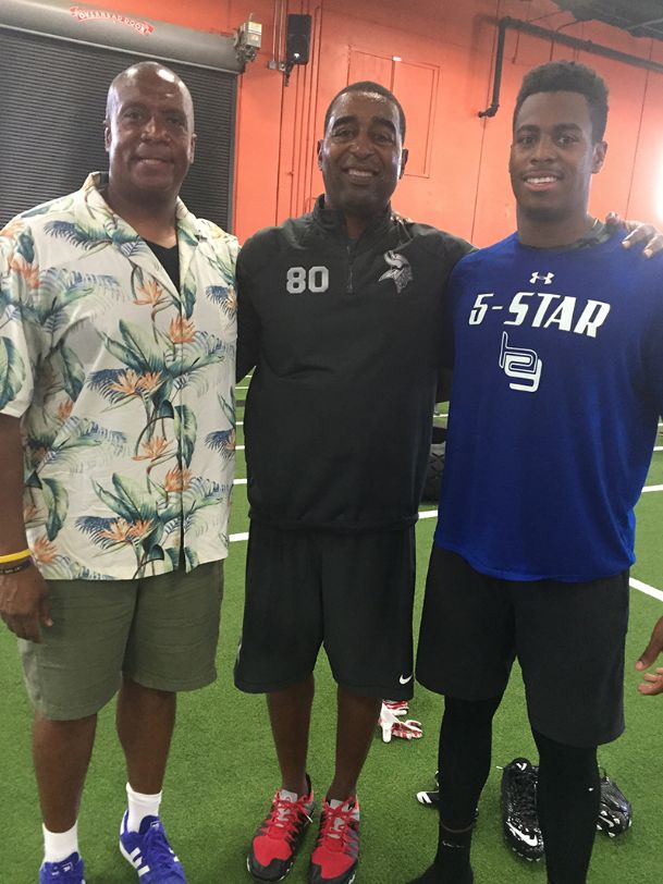 From left to right, future Big Ten commissioner Kevin Warren poses with Cris Carter and his son, Powers Warren in July of 2016 in Ft. Lauderdale, Fla.