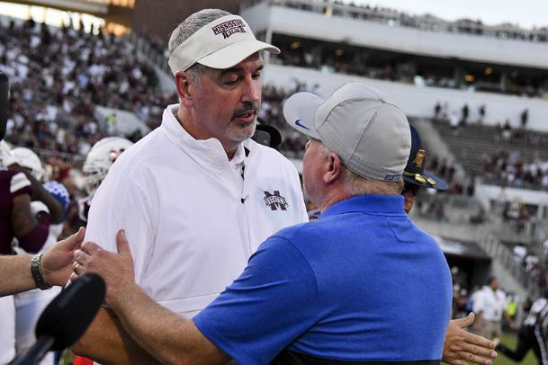 Mississippi State Bulldogs head coach Joe Moorhead and Kentucky Wildcats head coach Mark Stoops shake hands after the game at Davis Wade Stadium.
