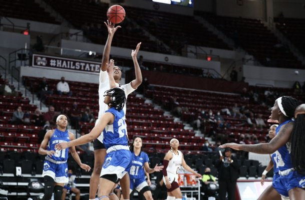 Jessika Carter skies over a New Orleans defender in Mississippi State's win over the Privateers Wednesday in Starkville.