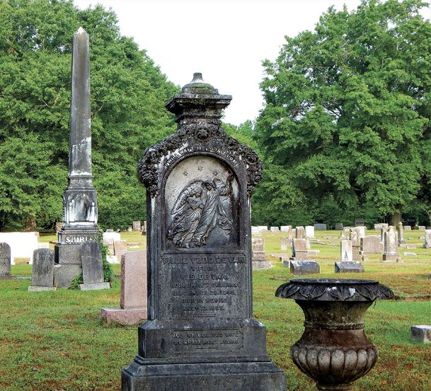 There is symbolism to be found in the old monuments of Friendship Cemetery. The urn in the foreground represents human mortality as does the Egyptian obelisk in the background. On the headstone in the center is an angel lifting the deceased to heaven.