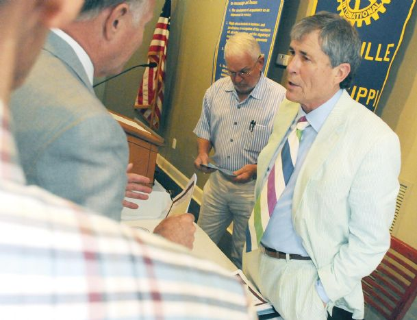 Lewis Whitfield, senior vice president of CREATE Foundation, speaks with members of  the Starkville Rotary Club following his keynote address Monday at the Starkville Country Club.