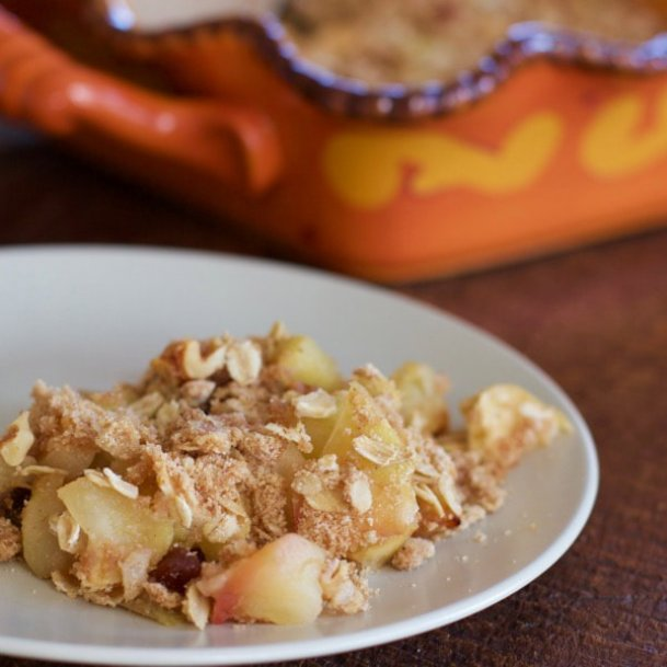 This nutty apple crisp contains delicious autumn flavors including apples, raisins, cinnamon, brown sugar and nuts.