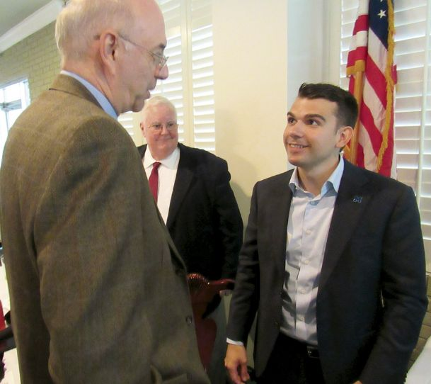 Starkville Rotary Club member John Forde, left, talks with Noah Barbieri after Monday's luncheon at Starkville Country Club. Barbeiri, a Millsaps College graduate, is headed to Oxford, England, next week as a Rhodes Scholar, the 51st Mississippian to earn the prestigious scholarship.