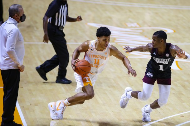 Tennessee guard Jaden Springer (11) drives to the lane while defended by Iverson Molinar (1) Tuesday in Knoxville. The Vols defeated Mississippi State 56-53.