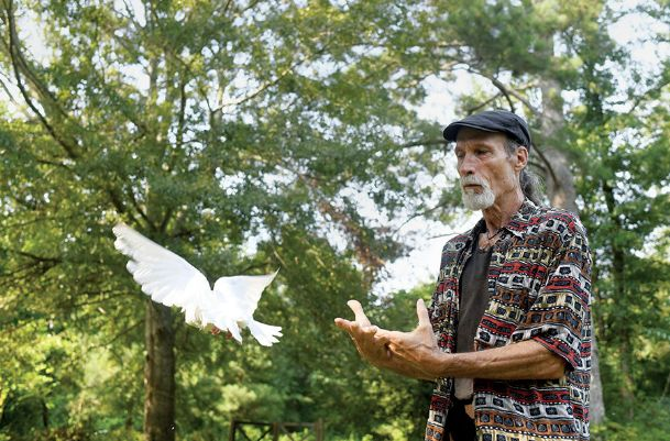 Larry Priest demonstrates a bird release on Wednesday at his home in Columbus. He has been releasing doves at weddings, funerals and other events across the state for more than 20 years. He also breeds doves and raises them along with his half-dozen or so chickens, three turkeys, two dogs and a horse.
