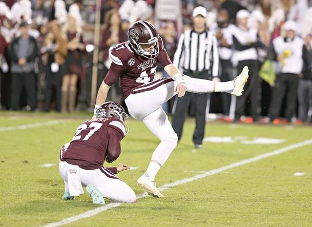 Mississippi State kicker Jace Christmann (right) currently holds program records in kicking points and PATs made.
