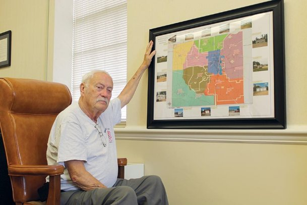 Kirk Rosenhan, who is retiring as Oktibbeha County fire services coordinator after almost 32 years, displays a map of the rural fire stations. Only two rural stations existed in Oktibbeha County in 1988 when he was appointed to his position. The creation of seven rural fire departments with a total of 14 stations is his legacy, he said.