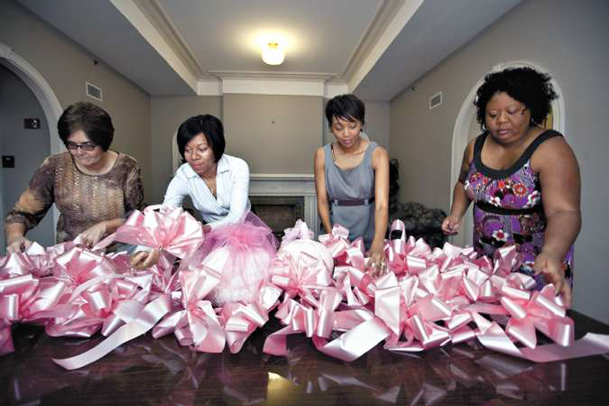 "Mississippi University for Women staff members gear up for the ""Pink for the Cure� events on campus. Organizing pink bows and pumpkins are, from left, Karen Partain, Rhonda Jones, Kimberly Taylor-Gathings and Rosamund Claudia McDavis."