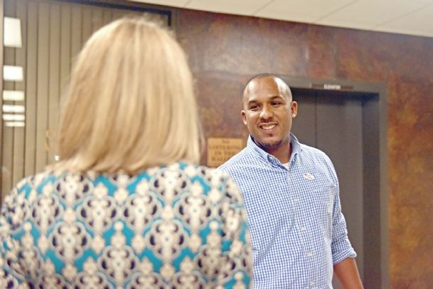 Scott Colom, a Columbus attorney, smiles while awaiting election results at the Lowndes County courthouse Tuesday.