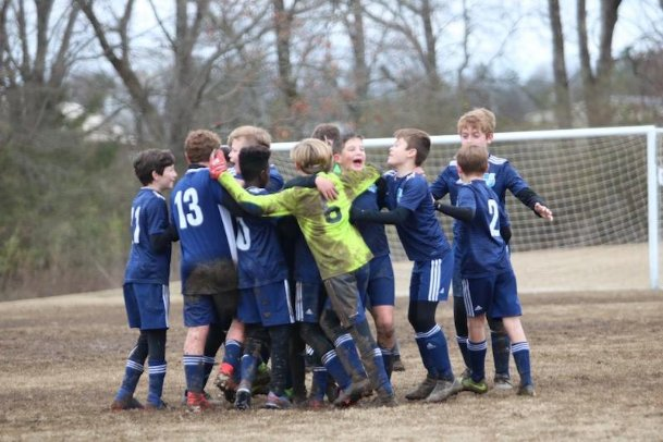 The Columbus United U12 boys team celebrates its championship victory over Tupelo Futbol Club-Amory during the Frostbite Tournament from Feb. 6-7 in Starkville.