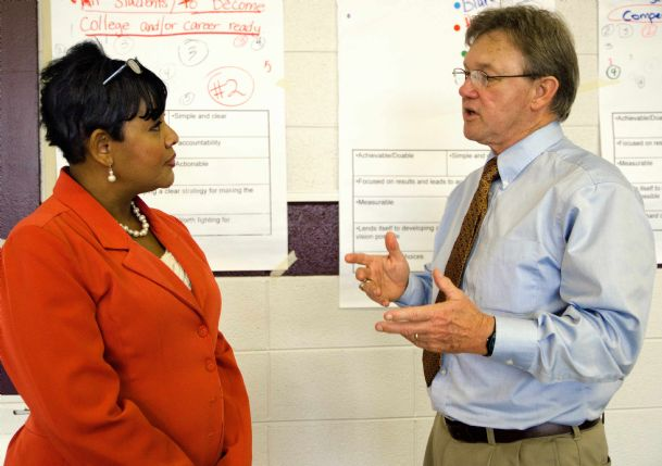 Dr. Martha Liddell talks with Mike Neyman, a consultant from the University of Mississippi's Institute for Education and Workforce Development, Saturday at Brandon Central Services.