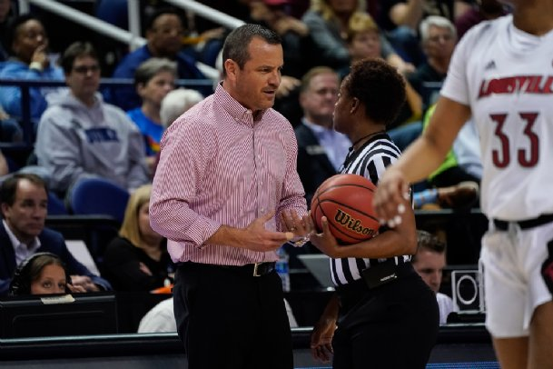 Louisville Cardinals head coach Jeff Walz talks a call over with the official during the first half against the Florida State Seminoles at Greensboro Coliseum on March 7. Walz is one of two finalists for the MSU job.