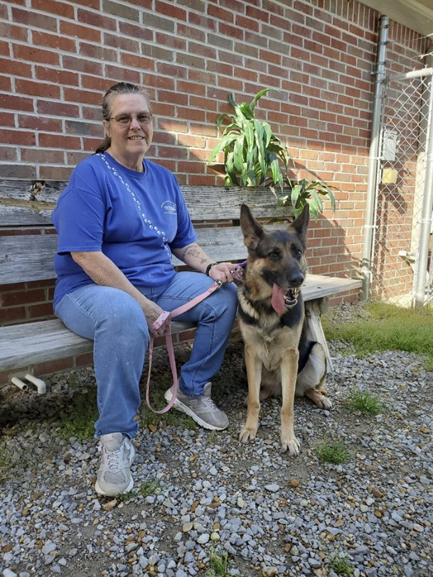 Columbus-Lowndes Humane Society staff member Trudy McDanell takes shelter resident Hidi out for a walk at the facility on Airline Road Wednesday. CLHS, like other area humane societies, has changed its policies in light of the spread of COVID-19.