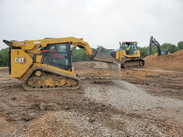 Winters Construction crews work Friday on a nine-acre lot on Reed Road in Starkville that is set to become an affordable housing complex with 36 single-family homes. The work began in April and is expected to be complete in the fall of 2021.