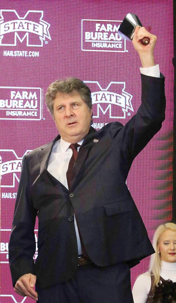 Mike Leach rings a cowbell at the end of the press conference introducing him as the 34th head football coach at Mississippi State on Friday in Starkville.