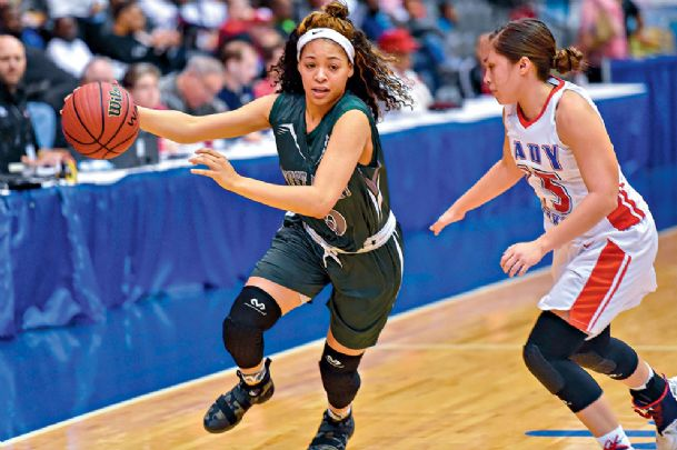 West Point High School's Tia McCrary (5) drives against Neshoba Central in their game Friday night at Mississippi Coliseum in Jackson.