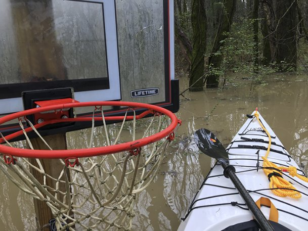 Recent downpours have forced road closings, created flooding in some areas and in one instance on Oak Slush Creek, eliminated the possibility of a pick-up game of hoops.