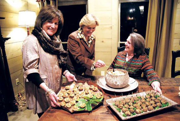 From left, Martha Bozeman, Sandra DePriest and Carla Guyton are pictured with three quick-and-easy appetizers suited to everything from a Super Bowl bash to an engagement party. The Columbus cooks share their recipes and tips today for mini tomato tarts, marinated shrimp and stuffed mushrooms.