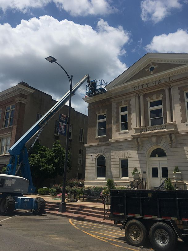 Hannah Greco/Dispatch Staff Construction continues for roof repairs on the recently renovated City Hall. In May, the council accepted a bid of $12,440 from Columbus-based Copper Top Construction after leaking was discovered.