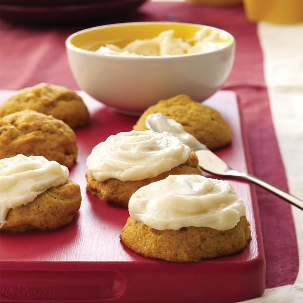 Cream cheese frosting tops these pumpkin cookies suited to any autumn occasion.