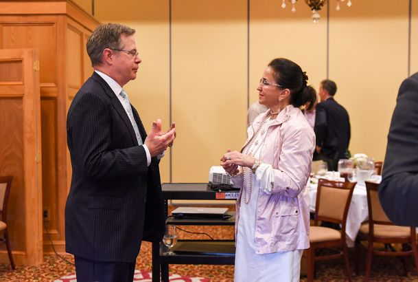 Ole Miss Chancellor Jeff Vitter visits with Doris Hardy after speaking on higher education during the Columbus Rotary Club's meeting at Lion Hills on Tuesday.
