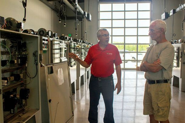 Stan West, left, a workforce technical instructor at East Mississippi Community College, shows Mike Clark one of the classrooms inside Communiversity. The building, which will open next month for the fall semester, was open to the public for three days last week for tours.