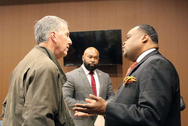 Area resident Roger Burlingame, left, speaks with Rep. Kabir Karriem (D-Columbus) while Rep. Cheikh Taylor (D-Starkville) looks on after the Chamber of Commerce's annual Education Town Hall at the Courtyard Marriott in Columbus Monday night. Karriem and Taylor were two of four legislators who, along with representatives from Columbus and Lowndes County school districts, answered questions about education posed by community members who attended the town hall.