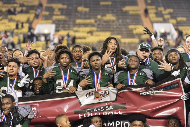 "West Point holds up the number ""four� after Saturday's state championship victory after their fourth straight championship. West Point captured its 11th title in school history Saturday."