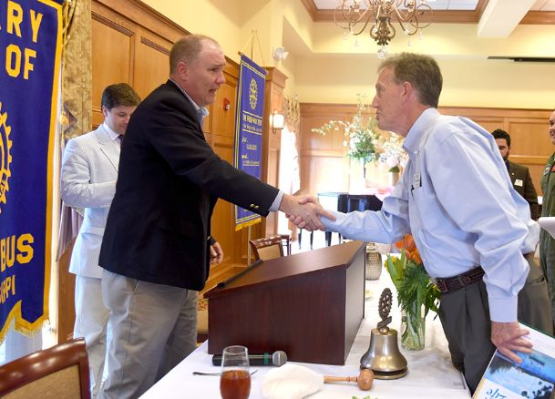 U.S. Rep. Trent Kelly visits with Roger Burlingame after speaking during a meeting of the Columbus Rotary Club at Lion Hills Center on Tuesday.