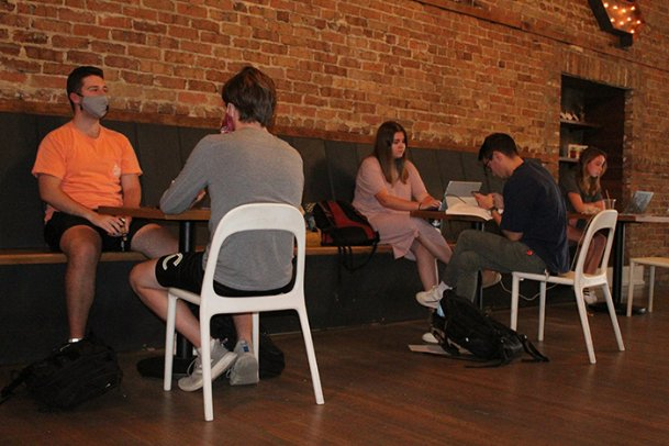From left: Eli Lawrence and Ben Nelson chat while Emily Brott, Truman Loupe and Lauren Jennings study at 929 Coffee Bar in downtown Starkville on Wednesday afternoon. The coffee shop started allowing indoor dining Monday after weeks of only allowing outdoor dining. Gov. Tate Reeves issued an executive order Monday allowing retailers and restaurants to operate at 75 percent capacity — up from the previous 50 — and relaxing several other mandates put in place to help curb the spread of COVID-19.