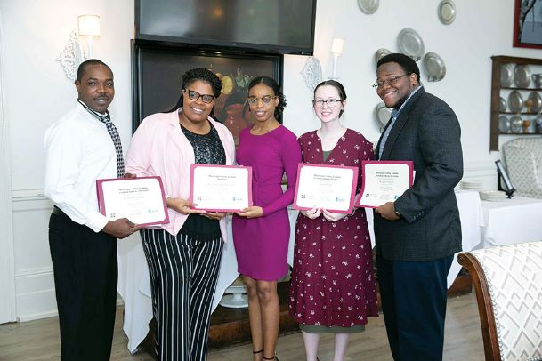 Golden Triangle Coding Academy coders Broderick Cattladge, Kayla Woodard, Leigh Jones, Angela Pugh and Kingdom McGee celebrate graduating on Saturday at the Waverly Country Club. Nine coders graduated in November, with six securing jobs after graduation. The academy is one of two in Mississippi that offers a tuition-free 11-month program which teaches the basics of coding and software development.