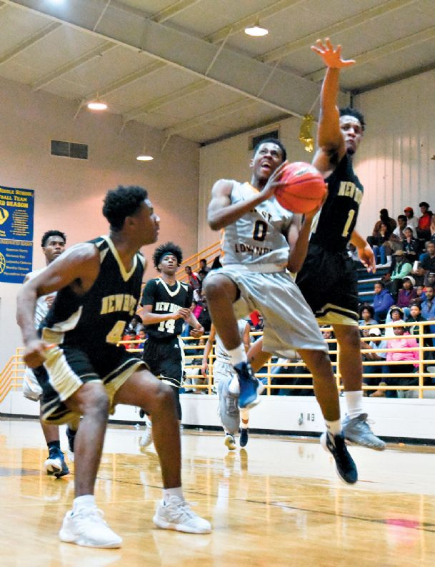 West Lowndes High School's Devon Chander (0) drives to the basket as New Hope Jay Shinn (right) and Terryonte Thomas defend in their game Tuesday night.