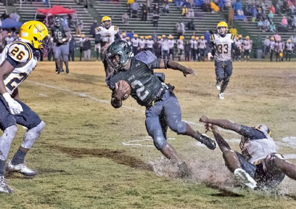 West Point High School's Brandon Harris escapes an Olive Branch tackler.