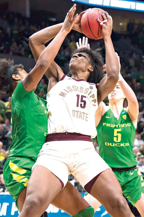 Mississippi State senior center Teaira McCowan attempts to move in for a shot against Oregon's double coverage in Sunday's NCAA Tournament game in Portland, Oregon. McCowan scored 19 points and had 15 rebounds in her final college game.